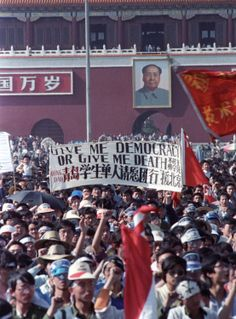 "China Detains Rights Lawyer Ahead of 25th Anniversary of Tiananmen Crackdown. Chinese students carry a sign that reads, ""Give me democracy or give me death,"" during a demonstration in Tiananmen Square May 14, 1989. Dominic Dudouble/Reuters"