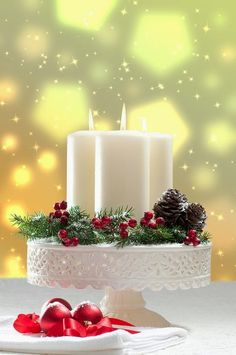 Christmas candles and greenery on a pretty cake plate