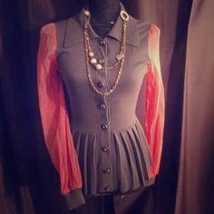 I just added this to my closet on Poshmark: Sheer sleeved orange peplum top. Price: $26 Size: XS