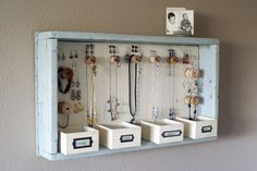 Totally need one of these. As someone who adores costume jewelry, it's getting out of hand and needs a place to go!
