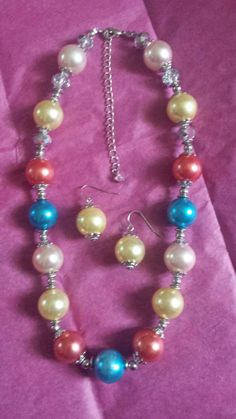 Check out this pearl necklace set in my Etsy shop https://www.etsy.com/listing/212043394/festive-pearls-necklace-set