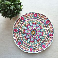"""""""Just one more row"""" she whispered late last night. """"Just one more row."""" Until she faceplanted with exhaustion into her work. """"Just one more row."""" Pattern: Overlay Crochet Mandala No. 5 by CAROcreated. by mobiusgirl"""