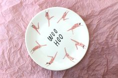 Hang it on the wall or eat your dinner off it! This plate features lots of naked people being free and careless. This plate has been hand painted