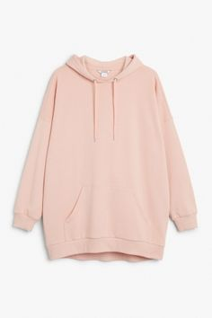 Monki Image 2 of Oversize hoodie  in Orange Reddish Light. this just looks so cozy like you could just curl up and hide in it