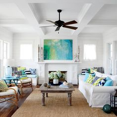 Walls in this sunny living room, and throughout the threestory home, are painted Vanilla Milkshake by Benjamin Moore. The creamy shade moderates the bright seaside light.