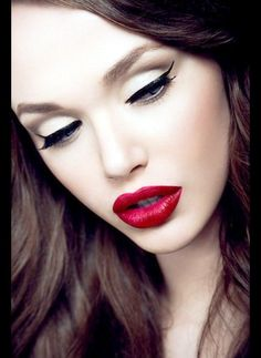 White shadow.  Black retro liner matched with bold red lips = wowza