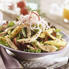 For this European-style main dish salad recipe, mix strips of cooked chicken, crisp radishes, baby corn, and green onions. Toss with a dressing of sesame oil, rice vinegar, and sesame seeds.