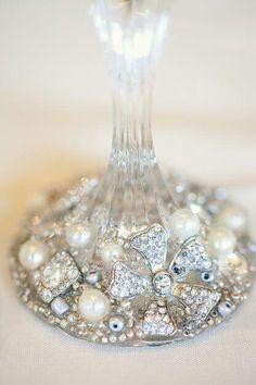 Embellish gemstones on the bottom of an upside-down wine glass.