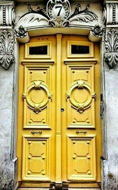 Yellow door number 7 in Paris, France.