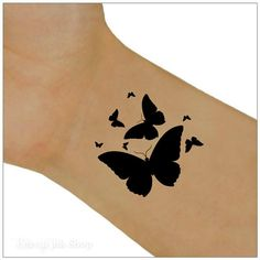 Butterfly temporary tattoos. Black butterfly wrist tattoos. You will receive 2 wrist tattoos and full instructions. Size: 1.5 x 1.5 The tattoos will last 5-7 days. Please read the full application instructions and care before applying the tattoo. You can remove the tattoo by rubbing the area with baby oil or use a sudsy washcloth. Temporary tattoos are not recommended for use on sensitive skin or if you have an allergy to adhesives. Do you like nail decals? We also have heart...