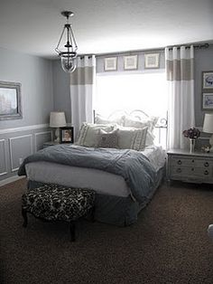 I'd like to try this kind of curtain on my bedroom wall to frame my bed - and I like the artwork above the window trim!
