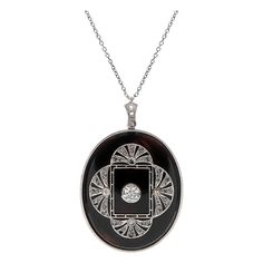 Art Deco Old European Cut Diamond & Onyx Pendant   From a unique collection of vintage drop necklaces at https://www.1stdibs.com/jewelry/necklaces/drop-necklaces/
