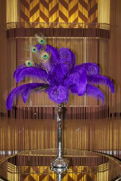 Seems like a must to have at least one of these somewhere. Purple feather centerpiece