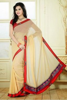 Beige Embriodered Georgette Saree; Paired With A Contrast Red Dupioni Raw Silk Blouse.The saree comes with an unstitched blouse piece.