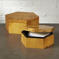 Shop burlwood hexagon storage boxes.   Deco hexagons covered in a layer of glossy burlwood veneer––a high-end material made popular in the 1920s.  Usually waaaay more expensive, we found a way to source it for less.