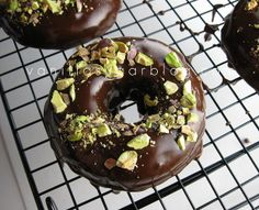 chocolate donuts with ganache & pistachios
