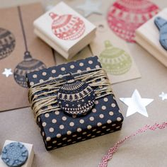 Cut out bauble pics from wrapping paper & make into gift tags! Also, wrap string round gift several times.