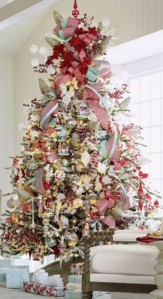 This festive finial-style tree topper is crafted of red mouth-blown glass that is decorated with glitter and handpainted white snowflakes. mouth-blown glass Handpainted Glitter Part of the Frosted Holiday Collection Indoor use A Frontgate exclusive.