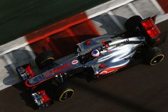 Jenson Button of Great Britain and McLaren drives during the final practice session
