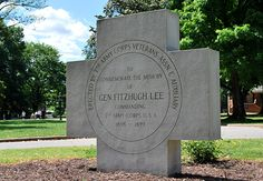 "1955 Anonymous FitHugh Lee Monmt, Richmond WHAT: ""Fitzhugh Lee"" monument in Monroe Park in downtown Richmond, Virginia.  LOCATION: Monroe Park is bordered by Franklin, Belvidere, Main and Laurel streets in the Fan District.  ARTIST: Unknown.  DEDICATION: April 21, 1955.  DESCRIPTION: A white stone cross 6-foot high memorializing General Fitzhugh Lee's efforts as a Commander of the 7th Army Corps USA 1898-1899. Erected by the 7th Army Corps Veterans Association and Auxiliary."