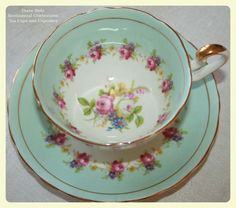 Tea cup, mint color with red roses,