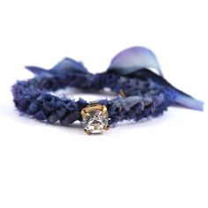 Founded by two best friends, frieda & nellie takes friendship bracelets to a new level of glam, the tie-on Wishing Bracelet features a hand-dyed, knotted silk ribbon with a sparkly rhinestone center.