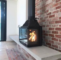 Beautiful hearth design with a corner view fireplace. Megowan Architectural have created this stunning,contemporary, concrete hearth for the Radiante cast iron 747 Installation by Fireworx Plumbing. Farmhouse Fireplace, Home Fireplace, Fireplace Hearth, Fireplace Design, Grafton House, Freestanding Fireplace, Home Deco, Building A House, New Homes