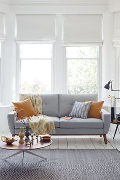 A sofa inspired by mid-century design, our Elvis sofa is a great choice for those looking to bring some retro flair into your home. This three-seat grey sofa is in Pumice house cotton blend and has wooden legs.