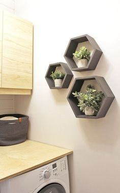 painted hexagon wall shelves with faux succulents in a laundry room Laundry Room Wall Decor, Small Laundry Rooms, Laundry Room Organization, Laundry Room Design, Laundry Area, Room Decor, Laundry Drying, Wall Shelves Design, Room Shelves