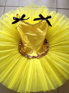 *Emma Wiggle Tutu*  DIY: Studio 7 yellow tutu + black ribbon + gold string sequins + hand stitching = very happy little girl!