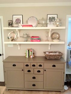 Buffet with shelves above it for extra storage and pretty display for cake plates etc.