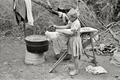 """My Party Dress"" February ""Child of white migrant worker ironing in tent camp near Harlingen, Texas."" negative by Russell Lee for the FSA. Vintage Pictures, Old Pictures, Old Photos, Shorpy Historical Photos, Migrant Worker, Dust Bowl, Vintage Laundry, Great Depression, Depression Support"