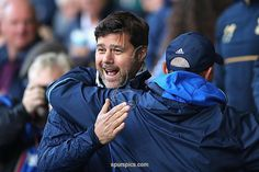 WEST BROMWICH, ENGLAND - OCTOBER 15: Mauricio Pochettino, Manager of Tottenham Hotspur (L) and Tony Pulis, Manager of West Bromwich Albion (R) embrace prior to kick off during the Premier League match between West Bromwich Albion and Tottenham
