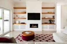 Shelves next to fireplace