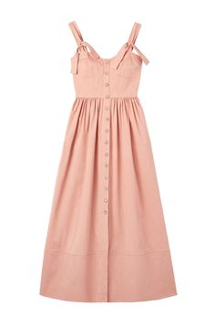 A button-front dress with a full skirt in dusty peach cotton sateen.