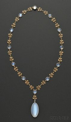 Arts & Crafts Moonstone and Split Pearl Necklace, Tiffany & Co., c. 1915-20, the large oval cabochon moonstone measuring approx. 30.00 x 16.10 x 10.50 mm, within a platinum bezel with foliate engraving, suspended from a chain of 18kt gold and split pearl lyre-form links spaced by cabochon moonstones in platinum bezels, chain lg. 18 5/8 in., signed Tiffany & Co. on the drop and on the clasp.