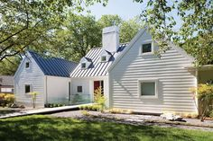 Modern farmhouse exterior design reflects the entire style of the space and the tradition as well. Revamping a farmhouse exterior can be very costly most of the time, depending on the chosen design. It is the facade of your whole… Continue Reading → Metal Roof Houses, Modern Farmhouse Exterior, Bungalow Exterior, Cottage Exterior, Dream House Plans, White Houses, Building Design, House Building, Modern Architecture