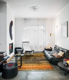 For the living room of their house in Genk, Belgium, Michaël Verheyden and Saartje Vereecke mixed furnishings of their own design with cl...