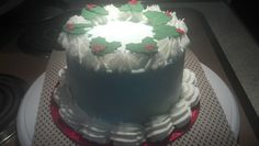 Secret Santa cake for my co-worker - buttercream with fondant holly leaves.