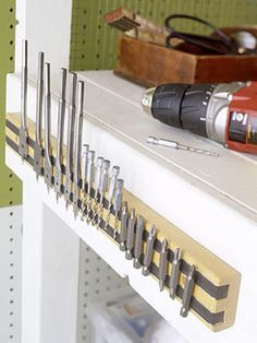 Here are some brilliantly clever garage organization tips! Clean up all the junk in your garage with these unique and creative ideas! Never misplace anything in your garage again with these guide to the perfect storage space. Garage Organization Tips, Garage Storage, Workbench Organization, Organizing Tips, Organising, Ladder Storage, Cabinet Storage, Wall Storage, Diy Storage