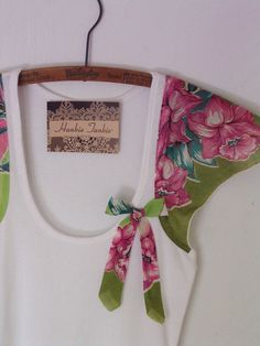 How adorable is this shirt?! what a great idea! taking pretty hankerchiefs and adding them onto a typical tank top to make it a pretty combo! I love it! I have one and I ordered it way too small..it gives me the urge to loose more weight! cant wait to wear it!