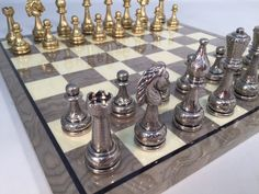This obviously gorgeous Large Metal Staunton Set With Grey Briar Board is a winner in so many ways! It is pure class, beauty, and luxury, to be played & enjoyed long into the future! Chess Pieces, Game Pieces, Popular Family Board Games, Chess Set Unique, Art Through The Ages, Classic Board Games, Deco, Chess Sets, Perfume Bottles