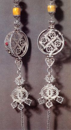 Pair of large silver earrings , Buryat group, Mongolia (Die Mongolen page 87 figure 90B)