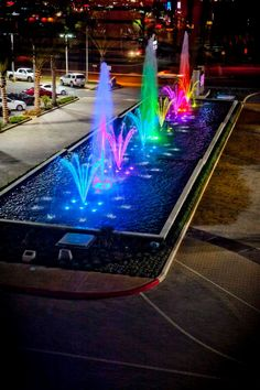 Colorful fountain at The Centre Escondido. Water Fountain Design, Pool Fountain, Waterfall Fountain, Diy Garden Fountains, Outdoor Fountains, Garden Ponds, Koi Ponds, Water Fountains, Fountain Lights