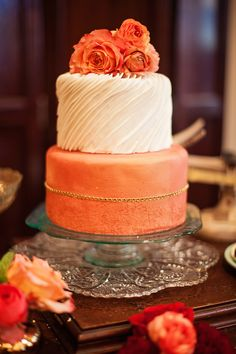 Peach wedding cake topped with ranunculus | Urban Safari Photography | see more on: burnettsboards.co...