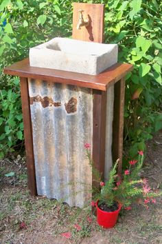 corrugated iron basin- outdoor  Google Image Result for http://tuchekoi-tubs.com/files/imagecache/product/no-2-tub.png