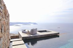 This stunning Mediterranean house is located on the Greek island of Syros. Designed by (an architecture and interior design studio based in Athens, Greece) this summer house was adapted to the steep, dramatic topography and is position Villa Am Meer, Hotel Am Meer, Home Cinema Room, Modern Mediterranean Homes, Belle Villa, Home Cinemas, Exterior, Interior Design Studio, Dream Decor