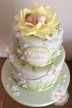 Garden baby shower cake  Baby in rose model www.wewantcake.co.uk