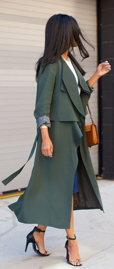 Draped Trench Jacket: Sheryl Luke is wearing a matte bottle green draped trench coat from French Connection