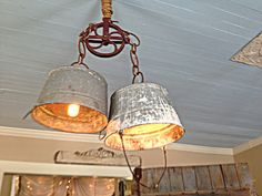 Upcycled buckets and pulley turned into a great light fixture